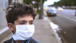 "A stranger in a surgical mask is a clear sign that flu season has arrived. It starts off slow — first a person riding the subway, a couple holding hands walking down the road. But as winter takes full effect, the masked population begins to increase. While these masks certainly seem like solid lines of defense against sickness, is wearing surgical masks one of the most important things you can do for your health, or are they simply a waste of money? Location For the record, according to the Centers for Disease Control and Prevention, the best protection against the flu is the flu vaccine (although this doesn't seem to be the case in this year's flu epidemic). Washing your hands frequently also offers indisputable protection against contagions. However, just because the surgical mask may not offer the best protection against the flu and other airborne diseases, this doesn't necessarily mean that it doesn't offer any protection. The face mask can be either highly effective or pretty much useless, all depending on where it's worn and what you're protecting either yourself or others from. The face mask is highly effective in preventing the transmission of disease when used inside of hospitals or other health care settings, The New York Times reported. Also, the mask works well in home settings where an infected individual is living in close proximity to uninfected family members. A 2008 study found that when used correctly those living with a sick family member were 80 percent less likely to be diagnosed with the illness. It's when people wear these masks in other locations that protection starts to waver and, frankly, the CDC is not quite clear what goes on when these masks are worn outside of health facilities. In a recent report on the subject, the organization wrote that ""very little information is available about the effectiveness of facemasks and respirators in controlling the spread of pandemic influenza in community settings."" Different Types of Masks If you are considering wearing a mask to protect against infections, there are two types you should know about. Facemasks Facemasks are fairly loosely fitting, disposable masks approved by the U.S. Food and Drug Administration for use as medical devices. Doctors, dentists, and nurses often wear them while treating patients. These masks prevent large droplets of bodily fluids that may contain viruses from escaping via the nose and mouth. Facemasks also protect against splashes and sprays from others, such as those from sneezes and coughs. The downside is that these masks don't prevent the inhalation of small, airborne contaminants. Respirators Respirators, also called N95 respirator masks, are designed to protect the wearer from small particles in the air that may contain viruses. They are certified by the CDC and the National Institute for Occupational Safety and Health. The name comes from the fact that they can filter 95 percent of airborne particles, according to the CDC. N95 masks are also often used when painting or handling potentially toxic materials. Respirators are selected to fit your face. They must form a perfect seal so that no gaps allow airborne viruses in. Healthcare workers use them to protect against airborne infectious diseases such as tuberculosis and anthrax. Unlike regular facemasks, respirators protect against both large and small particles. Overall, respirators are considered much more effective at preventing the flu virus than regular facemasks. Still, studies have found benefits to both types of masks. Guidelines for Wearing Facemasks The CDC revised its healthcare setting guidelines for flu prevention to include facemasks and respirators in 2010. They recommend that healthcare workers wear facemasks when working with patients who have the flu. They also suggest offering facemasks to patients who show signs of respiratory infections. Respirators, however, are reserved for healthcare workers to wear during medical procedures. Facemasks can help reduce the spread of the flu — but only if they're worn correctly and frequently. For example, several people were excluded from the results of the International Journal of Infectious Diseases study because they didn't wear their masks properly or when they should have. Here are some guidelines for proper mask-wearing: • Wear a facemask when coming within six feet of a sick person. • Position the strings to keep the mask firmly in place over the nose, mouth, and chin. Try not to touch the mask again until you remove it. • Wear a facemask before going near other people if you have the flu. • If you have the flu and need to see the doctor, wear a facemask to protect others in the waiting area. • Consider wearing a mask in crowded settings if the flu is widespread in your community or if you are at high risk for flu complications. • When you're done wearing the mask, throw it away and wash your hands. Never reuse a facemask. Bottom Line: To Wear, or Not to Wear When it comes to the flu, prevention is still the best method of keeping yourself safe from this highly contagious virus. A facemask may offer added protection against getting sick. There are no known risks to wearing these devices, except for the cost of buying them. Masks do seem promising, but it's also important to utilize other preventive measures, too. Make sure you wash your hands often during flu season — especially if you're around others who may be sick. Also, be sure to get your annual flu shot to protect yourself and others from spreading the virus. Sources: https://www.healthline.com/health/cold-flu/mask#4 http://www.medicaldaily.com/does-wearing-surgical-mask-during-flu-season-really-prevent-you-or-those-around-you-321452 https://www.mnn.com/health/fitness-well-being/stories/will-wearing-surgical-mask-prevent-flu"